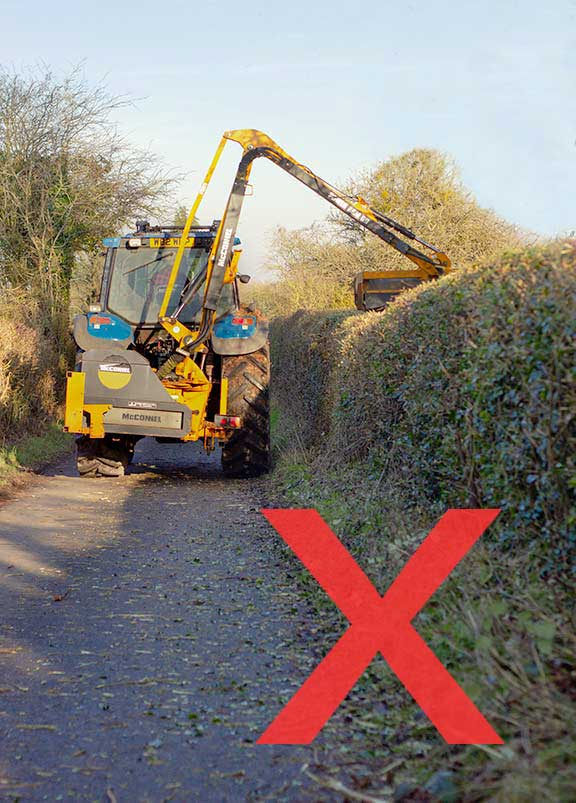 Tractor cutting hedge and wasting valuable crop
